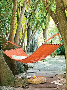 Keep waste out of a landfill, and give your backyard a much needed update with a hammock. This bright orange one is made from reclaimed seatbelts.