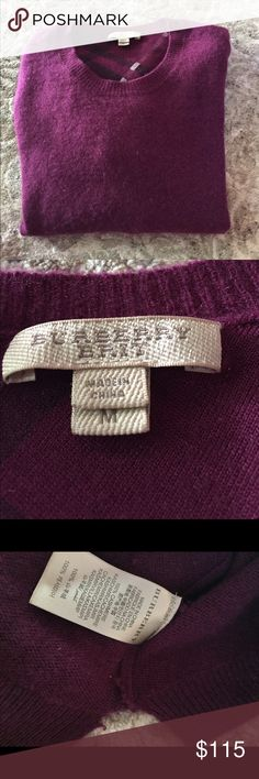 Burberry Brit cashmere sweater Gorgeous color Burberry Brit sweater. 100% cashmere and so luxurious. Very tiny pull in the sweater as shown in last pic, does not affect use. Priced accordingly.  Will bundle for 10% off Burberry Sweaters