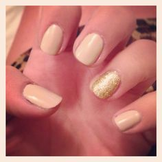 Neutral nails with gold glitter on ring fingers