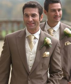 Gold groomsmen: darker gold tie, black suit but LOVE the vest