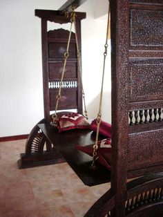 Traditional Indian jhoola/swing. Almost every state of the country has its own version. Wooden or metallic, it is an ornamental element of our traditional indian homes.