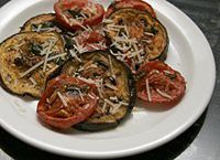 Roasted Eggplant and Tomatoes With Parmesan Cheese - Gonna try this with some kumatoes and provolone and put in in a wrap with greens