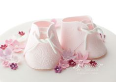 The cutest little pink sugar booties adorn the top of a gorgeous Christening cake featuring a water coloured base and ring of pretty sugar flowers Wedding Cookies, Wedding Favours, Cupcake Cookies, Cupcakes, Baby Shower Cakes For Boys, Pink Sugar, Occasion Cakes, Sugar Flowers, Christening