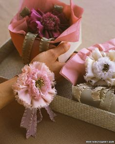 Fabric flowers from marthastewart.com.  Tutorial for these flowers can be found here: http://www.marthastewartweddings.com/226194/ribbon-crafts?page=1=272429=231155=104826