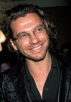 Michael Hutchence - love that smile. Definitely a case of smile and the whole world smiles with you