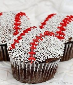 Simple baseball cupcakes!  Iced cupcakes rolled in white nonpareils then red stitching applied with icing.