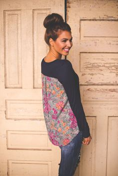 These colors and flowers are pretty...do not need sweaters though...Dottie Couture Boutique - Flower Print Back Top- Navy , $32.00 (http://www.dottiecouture.com/flower-print-back-top-navy/)