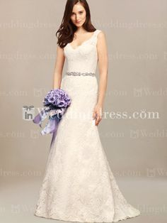 Elegant Lace wedding gown features a V-neckline and back with scalloped edging, fitted waist, and a beaded sash.