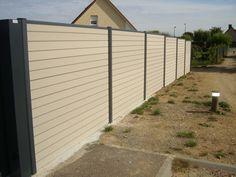 Installation de clôture en lames composites Océwood®