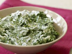 Creamed Spinach Recipe : after everything's combined I'd grate in Parmesan cheese because it needs to be cheesy. I would also add garlic powder to the wilting spinach and maybe add white wine to the rew to give it depth of flavor?