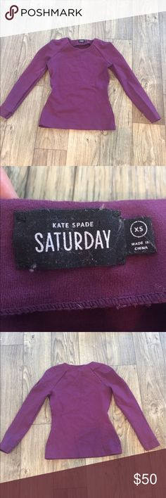 """Kate Spade Saturday Foldover Shoulder Skater Top Super cute Kate Spade Saturday Long Sleeve shirt. Slight flare at bottom. Maroon. Size XS. 72% Rayon, 25% nylon, 3% elastane. Thick and Sweatshirt-material-like. From back of collar to hem it's 21"""". Armpit to armpit is 15.5"""". The fabric is very stretchy. kate spade Tops"""
