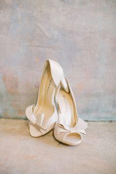 #bow heels - photo by Haley Sheffield - http://ruffledblog.com/modern-chic-atlanta-wedding/