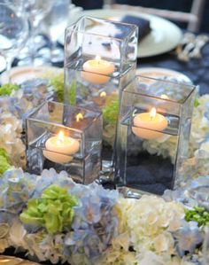 Candles and Hydrangea Centerpieces.  Really pretty arrangement. We have square floating candles as well to better fit square vases. Try them in lavander or other colors to fit the occasion.  Also available in bulk at www.BeverlyHillsCandle.com