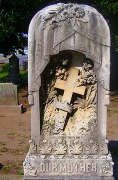 Incredibly detailed headstone .