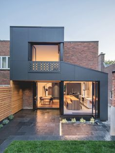 """This is the """"Black Box II,"""" a project by Natalie Dionne Architecture, located in Quebec, Canada. The art of architecture manifests itself here in all its dimensions. We love this semi-detached townhouse, made of red clay brick - what do you think? Architecture Renovation, Residential Architecture, Modern Architecture, Architecture Layout, Amazing Architecture, Semi Detached, Detached House, House Extension Design, House Design"""