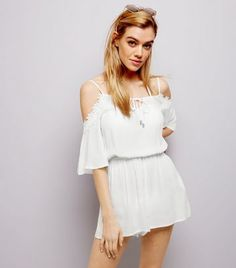 """Bring the cold shoulder trend into your holiday wardrobe this season with this appliqué trim playsuit.- Cold shoulders- Appliqué trim- 1/2 sleeves- Elasticated waist- Casual fit that is true to size- Joanna is 5'7""""/170cm and wears UK 10/EU 38/US 6"""