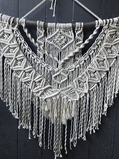 ✨MADE TO ORDER✨ This large macrame wall hanging can be a perfect addition to any room. It adds a little bit of creativity and depth without over taking the space it is placed in. LENGTH: Wooden Dowel: 36 inches Natural Stick: 48 inches Length of Macrame Pattern: 28 inches HEIGHT: