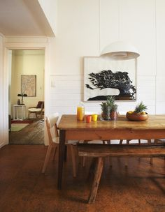 Love the warmth of the wood.  Is that cork flooring? Nice. Plus classic white.