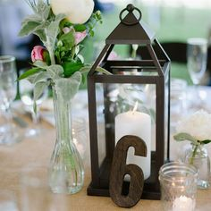 Tables were marked by dark wood number cut outs propped against simple candlelit lanterns. #timelesstreasure