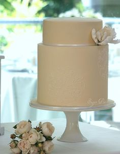 First Communion#order-love-simple-cakes-and-this-one-with-a-rough-butter-cream-finish-just-breaths-life-into-the-gumpaste-flowers-the-cake-top-and-bottom-tiers-both-had-4-ombre-shades-of-pink-butter-cake-layered-and-iced-with-french-vanilla-swiss-butter-cream
