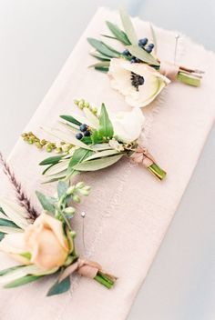 Love the green elements and ranunculus boutonnieres: http://www.stylemepretty.com/little-black-book-blog/2016/06/13/intimate-mountain-summer-wedding/   Photography: Lisa O'Dwyer - http://www.lisaodwyer.com/