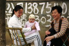 A mother's love, on a sidewalk in Loudi, Hunan Province, PR China