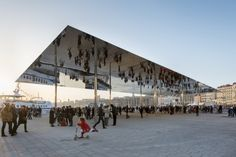 Marseille - the polished 46 by 22 meter stainless steel canopy amplifies and reflects the surrounding movement of the harbor,