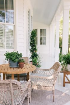 We are so excited to partner with Lowe's to give our front porch a beautiful makeover! We incorporated blues, greens and whites by adding plants, pots, and outdoor furniture. Shop our Lowe's front porch here! Farmhouse Front Porches, Southern Porches, Southern Homes, Southern Charm, Outdoor Dining, Outdoor Spaces, Outdoor Ideas, Outdoor Patios, Front Porch Makeover