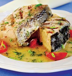 Photo about Grilled fish fillet in white wine sauce, cherry tomatoes and herbs on a white plate. Image of food, lose, eating - 22039019 Grilled Fish Fillet, Grilled Swordfish, Grilled Scallops, Grilled Pork Chops, Grilled Salmon, Grilled Tomatoes, Grilled Shrimp, Grilling Thick Pork Chops, Recipe Images