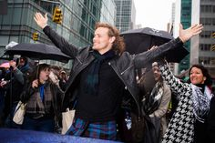 "Photographer Landon Nordeman tagged along as Heughan put on his kilt and hit the rainy streets, encountering fellow Scots, enthusiastic fans, and at least one dog eager to celebrate and say ""Sláinte!"""