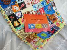 I spy Quilt Child's Large Look Quilt  Ispy  Eye Spy, Quiet Time Game. with Softcover Rhyming Book and Bright Frog print back Quiet Reading by StitchNWine on Etsy https://www.etsy.com/listing/209695948/i-spy-quilt-childs-large-look-quilt-ispy