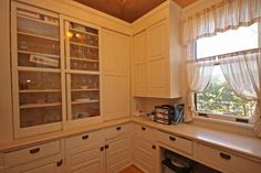 The first pantry I've seen with sliding doors like ours - a mix of glass and paneled on the same cabinet http://www.oldhousedreams.com/2015/10/22/1903-alexandria-mn/