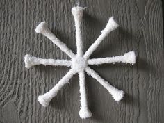 * golf tee snowflake - hot glue 8 tees together in a star shape, then paint with white glue and sprinkle with glitter