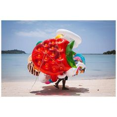 Photographer Davey Sexton (@daveysexton) made this picture during a trip to #Thailand. We spent three days in Koh Samui and every day this lovely man went up and down #Chaweng Beach selling these wonderful inflatables he remembers It was such a strange thing to see this giant bunch of colors approaching up the beach with only a pair of legs at the bottom to indicate that there was a human inside! // #contemporaryphotography #kohsamui #chawengbeach #documentaryphotography #streetphotography…