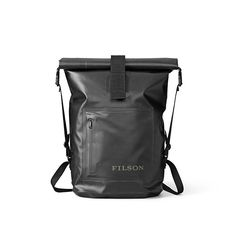 Filson Dry Day Backpack is a versatile daypack built to keep your gear safe from rain, wind and dust. Its oval base keeps it stable for loading, and the top rolls down to secure with a hook-and-loop closure. $125.