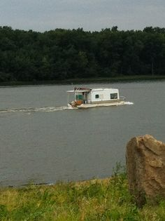 """Grafton, Illinois - Mississippi River - a """"Redneck"""" houseboat.  Yep, that's a camping trailer modified to a fishing boat....and they were frantically bailing out water as we watched.  Gotta love that redneck ingenuity!"""