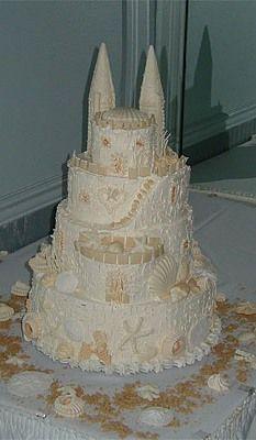 Beach theme wedding cakes  OMG! LOOKS LIKE A SAND CASTLE!!!!