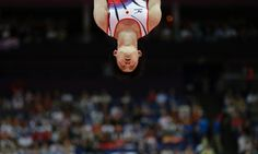 Japanese gymnast Yusuke Tanaka performs on the rings during the Artistic Gymnastic men's team final