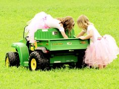 This is basically what my childhood looked like: a little disney princess on her john deere :D