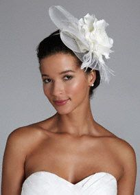 The perfect accessory for any true fasionista wanting to stand out on her special day!  Fascinator headband hat features stunning large flower, feather, and tulle accents.  Available in Ivory and White.  Imported.