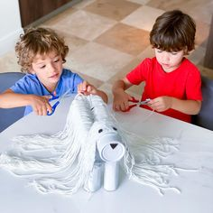"""Strengthen cutting skills while giving your kids their dream """"job"""" with this fun pet salon activity! Best part? It's made up of recyclables! Cutting Activities, Fine Motor Activities For Kids, Motor Skills Activities, Fine Motor Skills, Toddler Activities, Fun Learning, Preschool Activities, Strong Hand, Kids Cuts"""