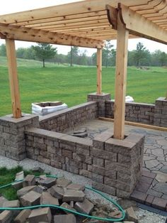 Add retaining wall to further define space and to add extra seating.  DIY Pergola Patio Retaining Wall