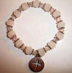 First Holy Communion Hope Angel Bracelet done in while jade swarovski crystal with clear spacers in between the larger beads. A small cross charm is attached.