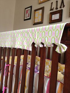 DIY:  Teething Rail Cover--  This one is a no brainer folks.  If you have a munchkin - it is a no sew method to prevent teeth marks all over your crib.