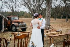 Hadley and Kodi's first look in front of the barn and antique pickup truck at their Vintage Rustic Georgia Wedding at Fritz Farm. TR Photography