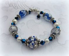 Blue and white lampwork glass bracelet with pearls and dangle charm