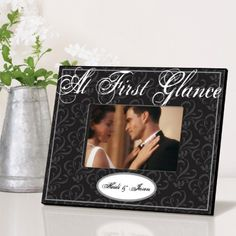 Looking for a classy wedding frame? This is the one! Elegant shades of black, white and gray, the Pe