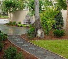 backyard walkway... gravel and stepping tones.  Nice way to cover up existing pavement walkway.