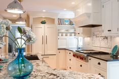 Delicatus Granite fits perfectly with many kitchen designs, styles, and colors because of its neutral, yet bold appearance. However, Delicatus White Granite with white cabinets is the most popular combination.  #kitchendesign #whitekitchendesign #delicatusgranite