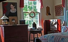 This room is warm and inviting.  I especially love the grapevine hanging on the window.